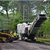 Chamblee Paving Machine and Bobcat working on a city street